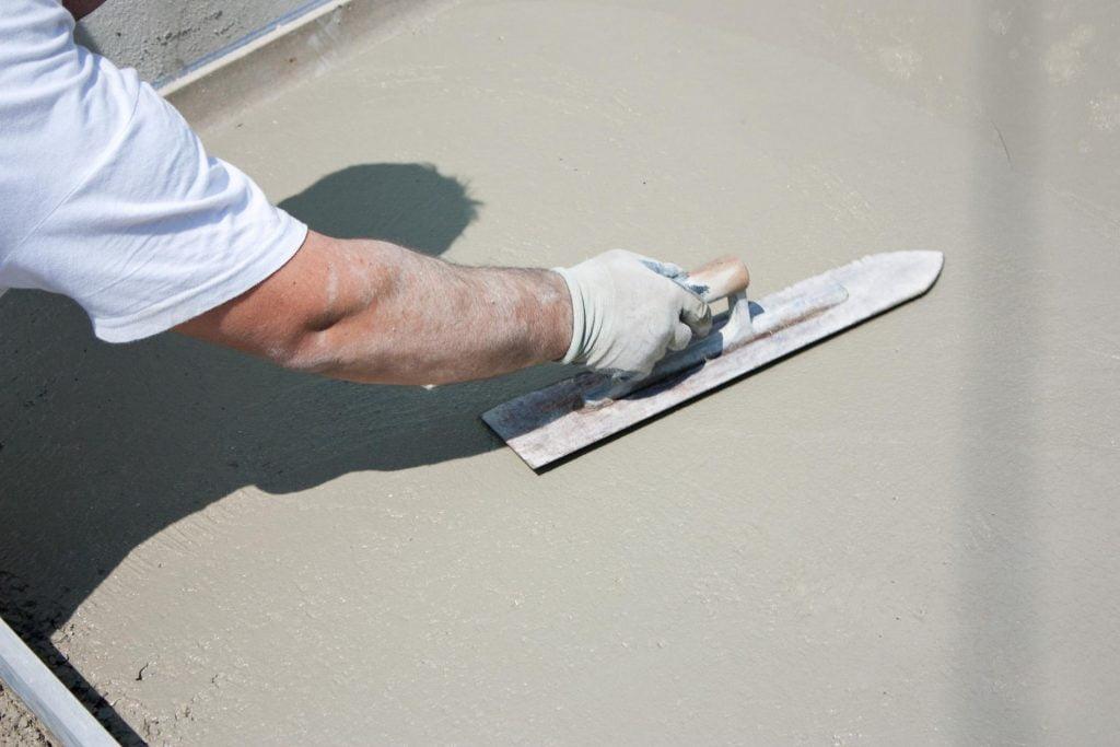 someone resurfacing the concrete