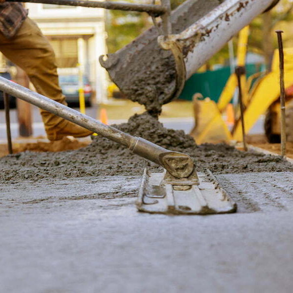 worker working for concrete pavement for ground at construction